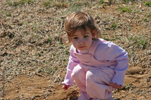 baby girl in dirt