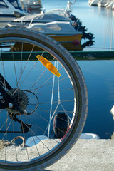 bicycle wheel and boats