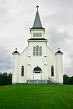 country church under a stormy sky poster