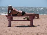 elderly woman on a beach poster