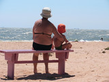 grandmother and  grandchild on a beach poster