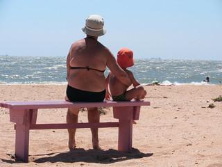 grandmother and  grandchild on a beach