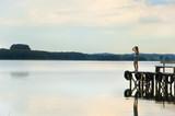 girl waiting on the lake bridge poster