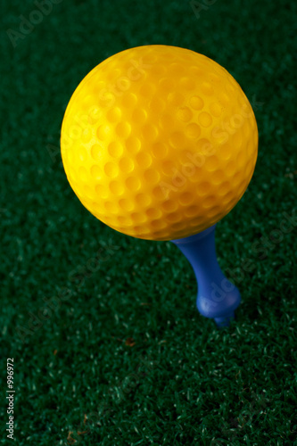 yellow golfball and blue tee
