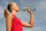 young woman drinking water poster