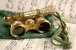 antique opera glasses on sheet music