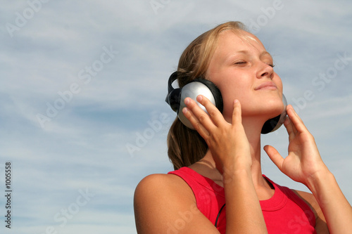 poster of girl wearing headphones
