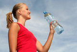 beautiful woman with bottle of mineral water poster
