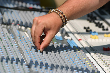 sound engineer at mixing desk