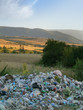 bunch of trash within nature - eco crisis
