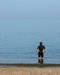 man standing in sea