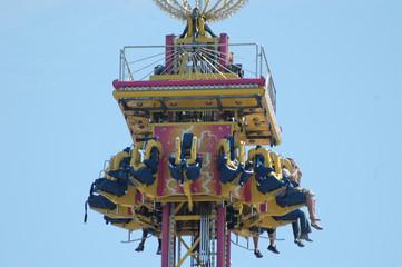 carnival riders in air