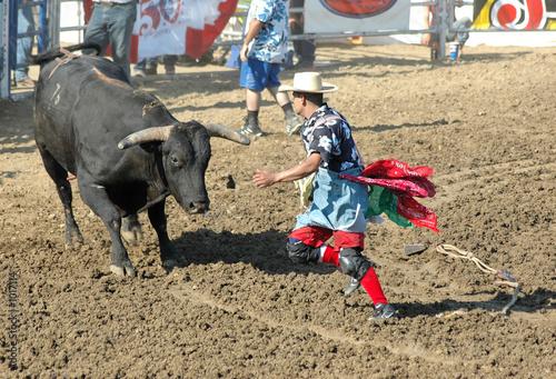 bull chasing rodeo clown