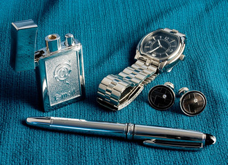 the watch, pen, cigarette-lighter and cuff links