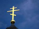 golden orthodox cross on blue sky poster