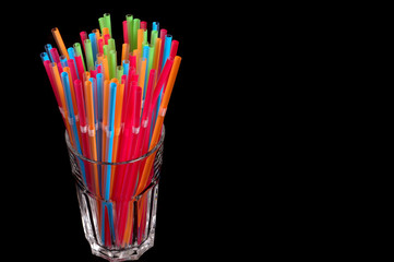 colorful straws in clear glass