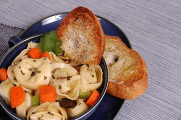 bowl of tortellini with crostini