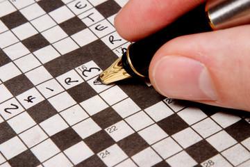 man completing crossword