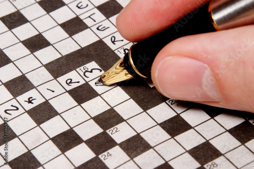 man completing crossword