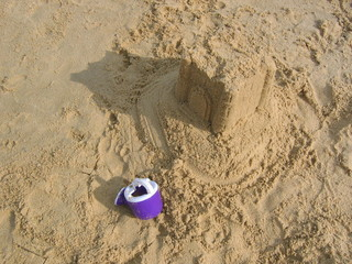 abandoned sand castle & watering can