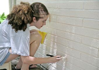 teen painting house trim