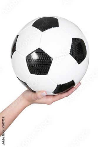 female hand holding a soccer ball