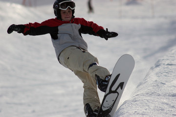 snowboarder jumping and grabbing his board