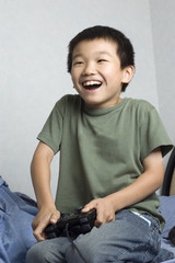 asian kid playing game