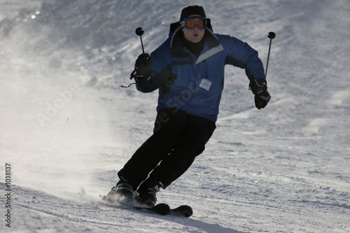 man skiing down the mountain
