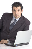 successful young businessman with a lap top comput poster