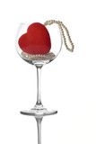empty glass with a red heart and a pearl necklace poster