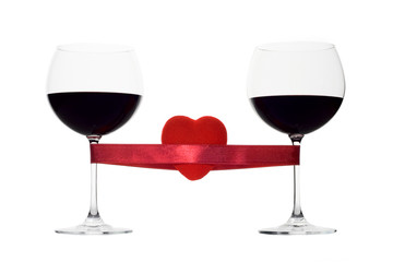 two wine glasses tied with a red heart