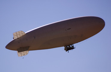 dirigible in blue sky