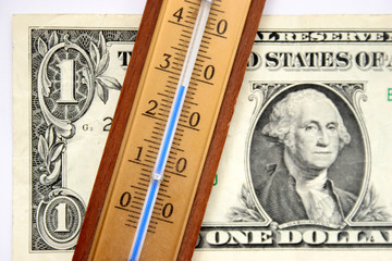 one dollar and thermometer
