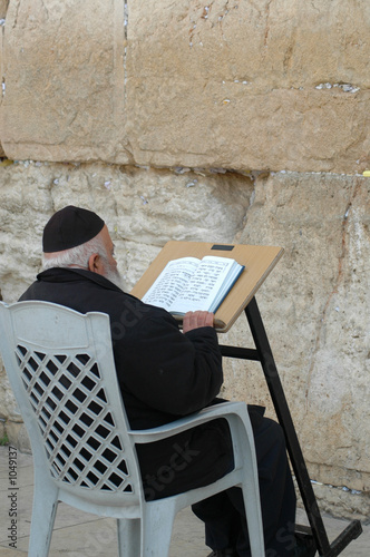 reading scripture at the western wall