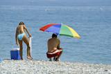 couple et un parasol poster