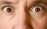 stock photo of the eyes of a surprised man poster