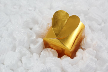 golden gift box in a shape of heart - celebration