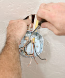 electrician attaching ceiling box poster