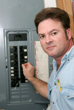 electrician at breaker panel poster