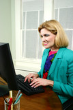 beautiful business woman typing and smiling poster