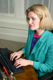beautiful business woman typing on computer poster