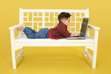 toddler with laptop poster