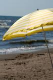 yellow beach umbrella poster