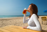 girl sitting&drinking on a beach-1 poster