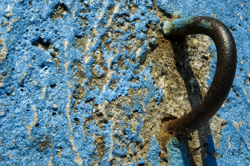 stone, metal and blue paint