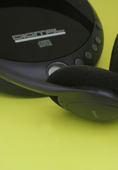 black headphones and a cd player