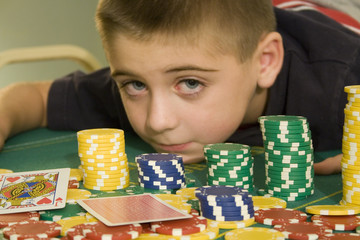 boy at the poker table