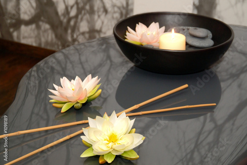 flowers, bamboo, stones and candle