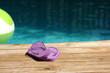 purple sandles at pool